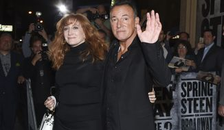 "FILE - In this Oct. 12, 2017 file photo, musician Bruce Springsteen and his wife Patti Scialfa exit the stage door after the ""Springsteen On Broadway"" opening night performance at the Walter Kerr Theatre in New York. Director Thom Zimny's ""Springsteen on Broadway"" film will appear on Netflix early in the morning of Dec. 16, hours after the singer's 236th and last performance. (Photo by Evan Agostini/Invision/AP, File)"