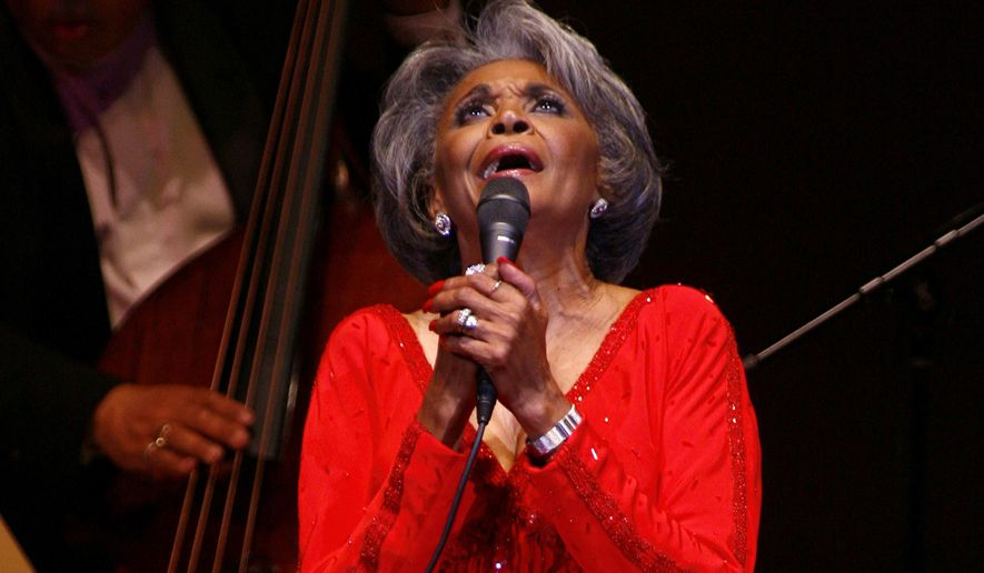 In this June 29, 2007, file photo, singer Nancy Wilson, performs at her Swingin' 70th Birthday Party at Carnegie Hall in New York. Grammy-winning jazz and pop singer Wilson has died at age 81. Her manager Devra Hall Levy tells The Associated Press late Thursday night, Dec. 13, 2018, that Wilson died peacefully after a long illness at her home in Pioneertown, a California desert community near Joshua Tree National Park. (AP Photo/Rick Maiman, File)