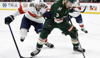 Minnesota Wild's Charlie Coyle (3) has the puck against Florida Panthers' Aleksander Barkov (16), of Finland, during the second period of an NHL hockey game Thursday, Dec. 13, 2018, in St. Paul, Minn. (AP Photo/Hannah Foslien)