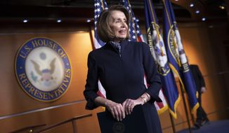 House Democratic leader Nancy Pelosi of California finishes a news conference at the Capitol in Washington, Thursday, Dec. 13, 2018. Pelosi has all but ensured she will become House speaker next month, quelling a revolt by disgruntled younger Democrats by agreeing to limit her tenure to no more than four additional years in the chamber's top post. (AP Photo/J. Scott Applewhite)