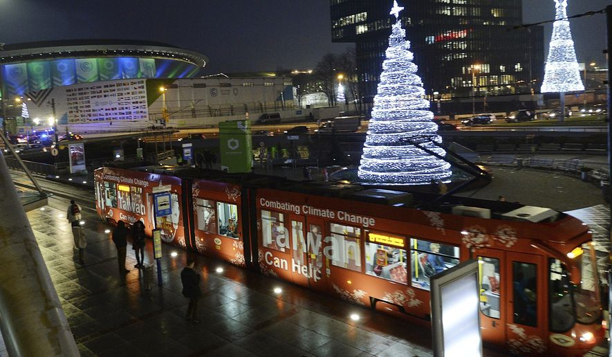 """A tramway at a stop near the """"Spodek"""" arena, part of the venue where U.N. climate talks are help on ways of combating global warming in Katowice, Poland, Wednesday, Dec. 12, 2018.(AP Photo/Czarek Sokolowski)"""