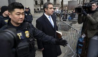 In this Dec. 12, 2018, photo, Michael Cohen, President Donald Trump's former lawyer, leaves federal court after his sentencing in New York. Trump has gone from denying knowledge of any payments to women who claim to have been mistresses to apparent acknowledgement of those hush money settlements – though he claims they wouldn't be illegal.  (AP Photo/Craig Ruttle)
