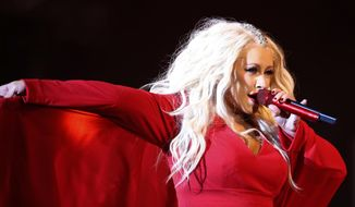 """FILE - In this May 28, 2016, file photo, Christina Aguilera performs during a concert at the annual Mawazine Music Festival in Rabat, Morocco. Aguilera will perform live minutes before the ball drops to usher in 2019 in New York's Times Square on """"Dick Clark's New Year's Rockin' Eve with Ryan Seacrest."""" (AP Photo /Abdeljalil Bounhar, File)"""