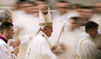 Pope Francis leaves after he celebrated Mass on the occasion of the feast of Our Lady of Guadalupe, in St. Peter's Basilica at the Vatican, Wednesday, Dec. 12, 2018. (AP Photo/Andrew Medichini)