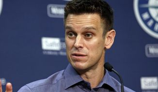 FILE - In this Oct. 3, 2017, file photo, Seattle Mariners general manager Jerry Dipoto speaks with reporters during a baseball news conference in Seattle. Dipoto was taken to a hospital after he fell ill during the winter meetings in Las Vegas. (AP Photo/Elaine Thompson, File)