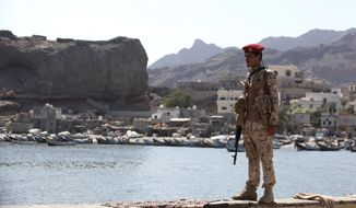 A soldier allied to Yemen's internationally recognized government stands guard at the fish market in Aden, Yemen, Thursday, Dec. 13, 2018. A sense of normalcy has returned to Aden, now the seat of power for Yemen's internationally recognized government, but many challenges remain for bringing a lasting peace to the Arab world's poorest country. (AP Photo/Jon Gambrell)
