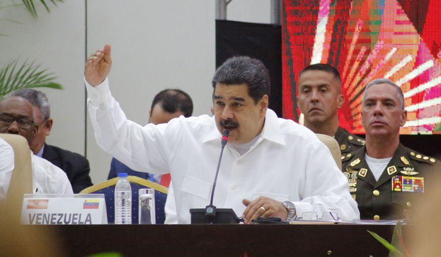 Venezuela's President Nicolas Maduro speaks at the Bolivarian Alliance for the Peoples of Our America, or ALBA, summit in Havana, Cuba, Friday, Dec. 14, 2018. (AP Photo/Desmond Boylan) ** FILE **