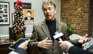 U.S. Sen. Rand Paul, R-Ky.. speaks to members of the media at his office, Friday, Dec. 14, 2018,  in Bowling Green, Ky. (Austin Anthony/Daily News via AP)