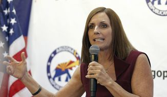 In this file photo from Thursday, Nov. 1, 2018, Rep. Martha McSally, R-Ariz., speaks at a campaign rally in Sun City, Ariz. (AP Photo/Matt York) ** FILE **