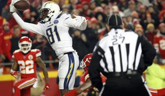 Kansas City Chiefs corner back Kendall Fuller, lower right, is called for pass interference against Los Angeles Chargers wide receiver Mike Williams (81) during the second half of an NFL football game in Kansas City, Mo., Thursday, Dec. 13, 2018. The call gave the Chargers a first-and-goal on the one-yard-line. The Los Angeles Chargers won 29-28. (AP Photo/Charlie Riedel)