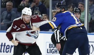 Colorado Avalanche's J.T. Compher (37) and St. Louis Blues' Brayden Schenn fight during the first period of an NHL hockey game Friday, Dec. 14, 2018, in St. Louis. (AP Photo/Jeff Roberson)