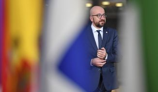 Belgian Prime Minister Charles Michel arrives for an EU summit in Brussels, Friday, Dec. 14, 2018. European Union leaders have offered Theresa May sympathy but no promises, as the British prime minister seeks a lifeline that could help her sell her Brexit divorce deal to a hostile U.K. Parliament. (AP Photo/Geert Vanden Wijngaert)
