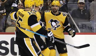 Pittsburgh Penguins' Zach Aston-Reese (46) celebrates his goal during the second period of an NHL hockey game against the Boston Bruins in Pittsburgh, Friday, Dec. 14, 2018. (AP Photo/Gene J. Puskar)