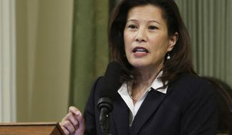 FILE - In this March 23, 2015, file photo, California Supreme Court Chief Justice Tani Cantil-Sakauye delivers her State of the Judiciary address before a joint session of the Legislature at the Capitol in Sacramento, Calif. The chief justice of the California Supreme Court says concerns about increasing polarization in the country prompted her to give up her Republican Party affiliation. Cantil-Sakauye said in a telephone interview on Friday, Dec. 14, 2018, that she switched her voter registration to no party preference after the confirmation hearings for U.S. Supreme Court Justice Brett Kavanaugh. But she said she had been considering the move for several years. (AP Photo/Rich Pedroncelli, File)