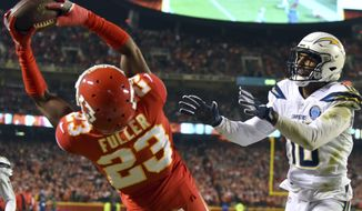 Kansas City Chiefs cornerback Kendall Fuller (23) intercepts a pass intended for Los Angeles Chargers wide receiver Tyrell Williams (16) during the first half of an NFL football game in Kansas City, Mo., Thursday, Dec. 13, 2018. (AP Photo/Ed Zurga)