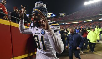 Los Angeles Chargers wide receiver Mike Williams (81) gestures as he leaves the field following an NFL football game against the Kansas City Chiefs in Kansas City, Mo., Thursday, Dec. 13, 2018. The Los Angeles Chargers won 29-28. (AP Photo/Ed Zurga)