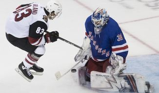 New York Rangers goaltender Henrik Lundqvist (30) makes a save against Arizona Coyotes right wing Conor Garland (83) during overtime of an NHL hockey game, Friday, Dec. 14, 2018, at Madison Square Garden in New York. (AP Photo/Mary Altaffer)