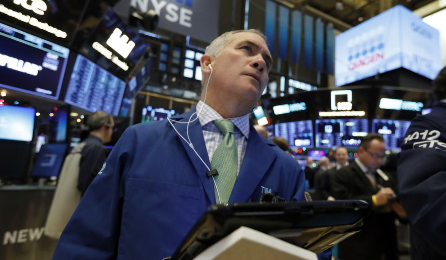 In this Nov. 29, 2018, file photo trader Timothy Nick works on the floor of the New York Stock Exchange. The U.S. stock market opens at 9:30 a.m. EST on Friday, Dec. 14. (AP Photo/Richard Drew, File)