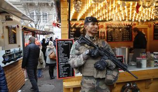 A French soldiers patrols as the Christmas market reopens in Strasbourg, eastern France, Friday, Dec.14, 2018. The man authorities believe killed three people during a rampage near a Christmas market in Strasbourg died Thursday in a shootout with police at the end of a two-day manhunt, French authorities said. (AP Photo/Christophe Ena)