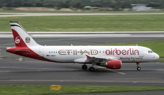 "FILE - In this Aug. 16, 2017 file photo an aircraft of  ""Air Berlin"" with the writing Etihad taxies at the Duesseldorf, western Germany, airport.  A Berlin court said Friday, Dec. 14, 2018 the insolvency administrator for bankrupt airline Air Berlin has sued its former largest shareholder, Gulf airline Etihad, for 2 billion euros (US$2.26 billion) in damages.  (Federico Gambarini/dpa via AP)"