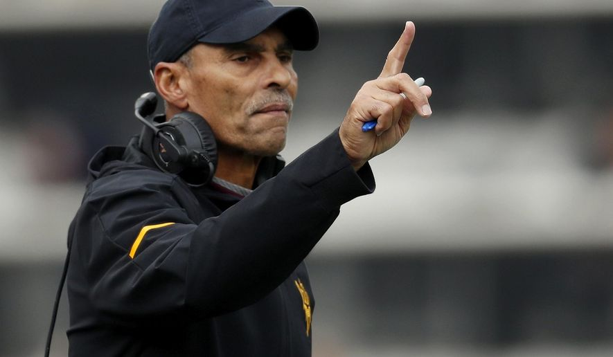 FILE - In this Saturday, Oct. 6, 2018, file photo, Arizona State head coach Herm Edwards gestures during the first half of an NCAA college football game in Boulder, Colo. Arizona State plays Fresno State in the Las Vegas Bowl, Saturday, Dec. 15, 2018. (AP Photo/David Zalubowski, File)
