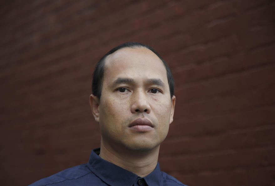FILE - In this Oct. 23, 2018 photo, Borey Ai pauses outside of the Asian Americans Advancing Justice-Asian Law Caucus in San Francisco. Ai spent 19 years in prison before parole officials decided he'd turned his life around and he walked out of San Quentin and into the waiting arms of federal immigration agents. In a rare step, the California Supreme Court has blocked Gov. Jerry Brown's attempt to issue a pardon to a 37-year-old man Cambodian refugee facing deportation for killing and robbing a woman when he was 14 years old. The court offered no public explanation for its rejection on Wednesday, Dec. 5, 2018 of Borey Ai's pardon. (AP Photo/Jeff Chiu, File)