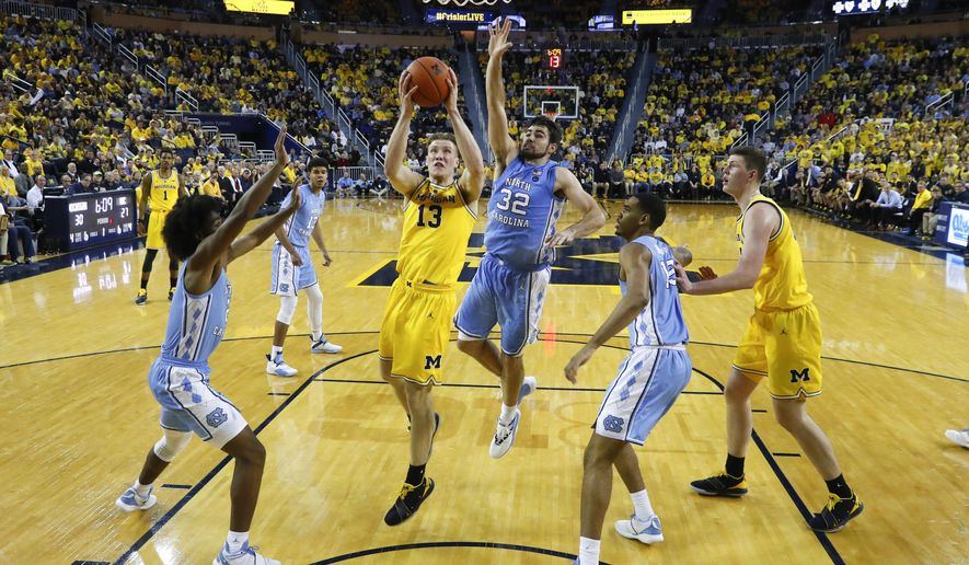 FILE - In this Nov. 28, 2018, file photo, Michigan forward Ignas Brazdeikis (13) drives against North Carolina in the first half of an NCAA college basketball game, in Ann Arbor, Mich. No. 12 North Carolina hasn't been good enough defensively in either of its two losses. The Tar Heels can't afford to repeat those issues Saturday with fourth-ranked Gonzaga coming to Chapel Hill. (AP Photo/Paul Sancya, File)