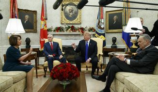 FILE - In this Tuesday, Dec. 11, 2018 file photo, House Minority Leader Rep. Nancy Pelosi, D-Calif., Vice President Mike Pence, President Donald Trump, and Senate Minority Leader Chuck Schumer, D-N.Y., argue during a meeting in the Oval Office of the White House in Washington. On Friday, Dec. 14, 2018, The Associated Press has found that stories circulating on the internet that Democrats gave a $150 billion payout from the U.S. treasury to Iran, are untrue. (AP Photo/Evan Vucci)