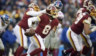 FILE - In this Dec. 9, 2018, file photo, Washington Redskins quarterback Josh Johnson runs with the ball during the second half of an NFL football game against the New York Giants, in Landover, Md. (AP Photo/Nick Wass)