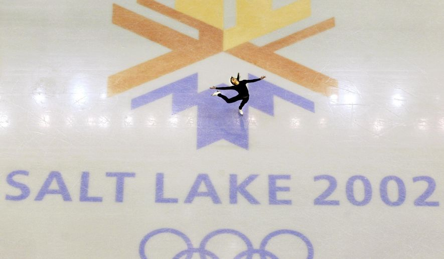 FILE - This Feb. 8, 2002, file photo, shows U.S. champion Michelle Kwan practicing for the women's short program for the Winter Olympic Games at the Salt lake Ice Center in Salt Lake City. Salt Lake City got the green light to bid for an upcoming Winter Olympics most likely for 2030 in an attempt to bring the Games back to the city that hosted in 2002 and provided the backdrop for the U.S. winter team's ascendance into an international powerhouse. (AP Photo/Doug Mills, file)