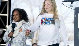 """FILE - In this March 24, 2018 file photo, Yolanda Renee King, grand daughter of Martin Luther King Jr., left, accompanied by Jaclyn Corin, right, a student at Marjory Stoneman Douglas High School in Parkland, Fla., and one of the organizers of the rally, speaks during the """"March for Our Lives"""" rally in support of gun control in Washington. Corin who survived the school shooting massacre and co-founded the """"March For Our Lives"""" gun-reform movement has been accepted to Harvard. The senior student Corin posted a photo of her admissions notice on Instagram on Thursday, Dec. 13, 2018. (AP Photo/Andrew Harnik, File)"""