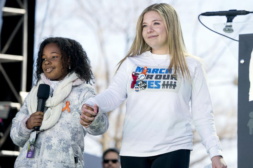 "FILE - In this March 24, 2018 file photo, Yolanda Renee King, grand daughter of Martin Luther King Jr., left, accompanied by Jaclyn Corin, right, a student at Marjory Stoneman Douglas High School in Parkland, Fla., and one of the organizers of the rally, speaks during the ""March for Our Lives"" rally in support of gun control in Washington. Corin who survived the school shooting massacre and co-founded the ""March For Our Lives"" gun-reform movement has been accepted to Harvard. The senior student Corin posted a photo of her admissions notice on Instagram on Thursday, Dec. 13, 2018. (AP Photo/Andrew Harnik, File)"