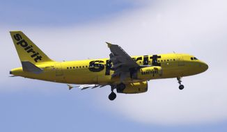 File-This May 24, 2018, file photo shows a Spirit Airlines passenger jet plane, an Airbus 319 model, approaching Logan Airport in Boston. Spirit Airlines tops the latest ratings for on-time flights, a stunning turnaround for a discount carrier that consistently ranked as the tardiest airline in America three years ago.The Transportation Department said Friday, Dec. 14, 2018, that 89 percent of Spirit's flights in October arrived on time, putting Spirit just ahead of frequent winner Hawaiian Airlines and Delta.  (AP Photo/Charles Krupa, File)