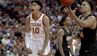 FILE - In this Wednesday, Dec. 5, 2018 file photo, Texas forward Jaxson Hayes (10) celebrates a dunk during an NCAA college basketball game against Virginia Commonwealth in Austin, Texas. Texas freshman Hayes is a meteoric rise from raw talent to early buzz as a potential 2019 NBA draft pick. (Nick Wagner/Austin American-Statesman via AP, File)
