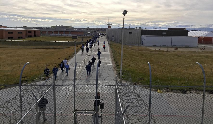 "FILE - In this Jan. 30, 2018 file photo, inmates walk across the grounds of the Idaho State Correctional Institution in Kuna, Idaho. Idaho transgender inmate Adree Edmo has spent most of her prison term at this men's prison facility. A federal judge ruled Thursday, Dec. 13, 2018 that the state must provide Edmo with gender confirmation surgery to make her physical characteristics match her gender identity as a woman."" (AP Photo/Rebecca Boone, File)"