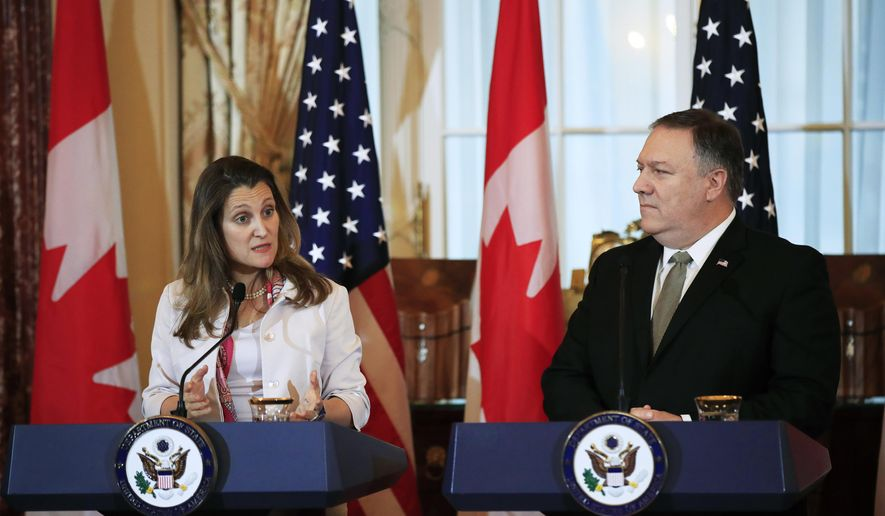 Canadian Minister of Foreign Affairs Chrystia Freeland, left, with Secretary of State Mike Pompeo, speaks to reporters during a news conference at the State Department in Washington, Friday, Dec. 14, 2018. (AP Photo/Manuel Balce Ceneta)