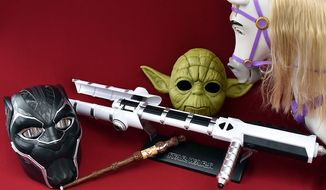 Gift ideas for role players include Marvel Legends: Black Panther Helmet, Wizard Training Wand, Force FX Z6 Riot Control Baton, Yoda Electronic Mask and Disney's Playdate Maximus. (Photograph by Joseph Szadkowski / The Washington Times)