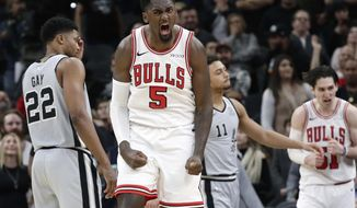 Chicago Bulls forward Bobby Portis (5) celebrates during the final seconds of the second half of an NBA basketball game against the San Antonio Spurs, Saturday, Dec. 15, 2018, in San Antonio. San Antonio won 98-93. (AP Photo/Eric Gay)