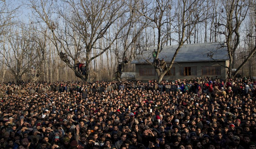 Kashmiri villagers watch the joint funeral of a civilian Abid Lone and local rebel Adnan Ahmed in Pulwama, south of Srinagar, Indian controlled Kashmir, Saturday, Dec. 15, 2018. At least seven civilians were killed and nearly two dozens injured when government forces fired at anti-India protesters in disputed Kashmir following a gunbattle that left three rebels and a soldier dead on Saturday, police and residents said. (AP Photo/ Dar Yasin)