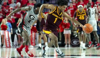 Arizona State guard Remy Martin (1) turns up the floor after stealing the ball from Georgia guard Tyree Crump during the second half of an NCAA college basketball game Saturday, Dec. 15, 2018, in Athens, Ga. (AP Photo/John Amis)