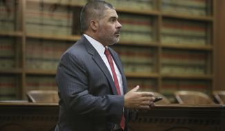 In this Oct. 17, 2018, file photo, McLennan County District Attorney Abelino Reyna arrives for a hearing in 54th District Court during a hearing in Waco, Texas. (Rod Aydelotte/Waco Tribune-Herald via AP)