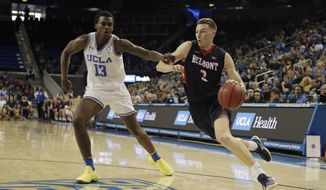 Belmont guard Dylan Windler (3) is defended by UCLA guard Kris Wilkes (13) during the first half of an NCAA college basketball game Saturday, Dec. 15, 2018, in Los Angeles. (AP Photo/Marcio Jose Sanchez)