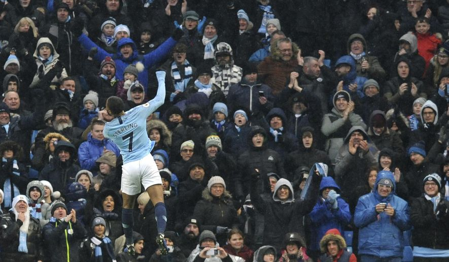 Manchester City's Raheem Sterling celebrates after scoring his sides third goal during the English Premier League soccer match between Manchester City and Everton at Etihad stadium in Manchester, England, Saturday, Dec. 15, 2018. (AP Photo/Rui Vieira)