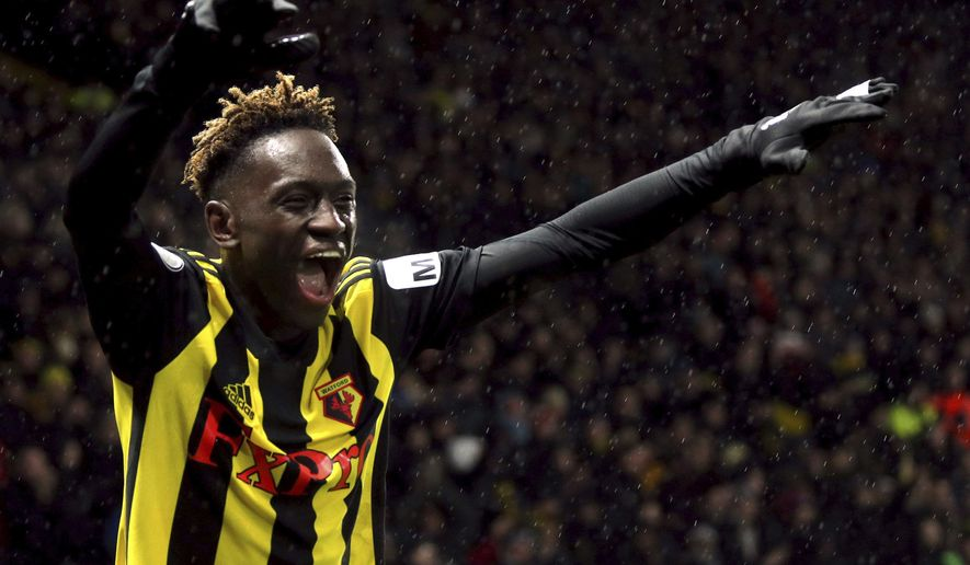 Watford's Domingos Quina celebrates scoring his side's third goal of the game during the English Premier League soccer match between Watford F.C and Cardiff City at Vicarage Road stadium, London, England. Saturday Dec. 15, 2018. (Yoi Mok/PA via AP)