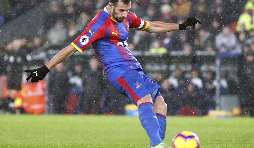 Crystal Palace's Luka Milivojevic scores his side's first goal of the game during the English Premier League soccer match between Crystal Palace and Leicester City at Selhurst Park Stadium, London. Saturday Dec. 15, 2018. (Adam Davy/PA via AP)