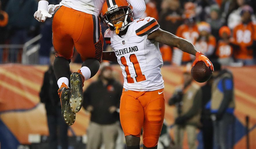 Cleveland Browns wide receiver Antonio Callaway (11) celebrates his touchdown with teammate David Njoku (85) during the second half of an NFL football game against the Denver Broncos, Saturday, Dec. 15, 2018, in Denver. (AP Photo/Jack Dempsey)