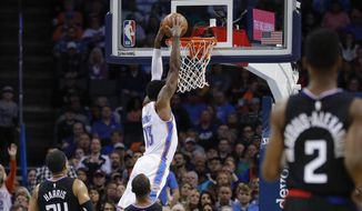 Oklahoma City Thunder forward Paul George (13) dunks against the Los Angeles Clippers during the first half of an NBA basketball game in Oklahoma City, Saturday, Dec. 15, 2018. (AP Photo/Alonzo Adams)
