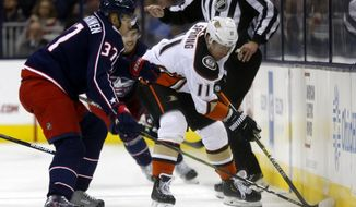 Anaheim Ducks forward Daniel Sprong, right, of the Netherlands, controls the puck against Columbus Blue Jackets forward Markus Hannikainen, of Finland, during the second period of an NHL hockey game in Columbus, Ohio, Saturday, Dec. 15, 2018. (AP Photo/Paul Vernon)