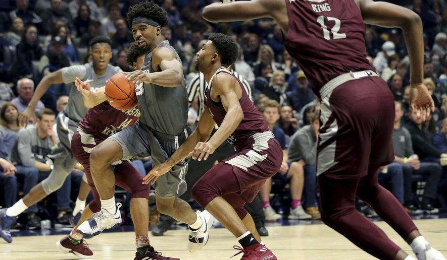 Xavier guard Quentin Goodin (3) drives the basket in the first half of an NCAA college basketball game against Eastern Kentucky, Saturday, Dec. 15, 2018, in Cincinnati, Ohio. (Kareem Elgazzar/The Cincinnati Enquirer via AP)