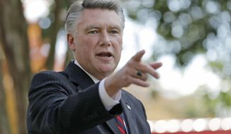 FILE - In this Nov. 7, 2018, file photo, Mark Harris speaks to the media during a news conference in Matthews, N.C. The nation's last unresolved fall congressional race with Harris against Democrat Dan McCready is awash in doubt as North Carolina election investigators concentrate on a rural county where absentee-ballot fraud allegations are so flagrant they've put the Election Day result into question. (AP Photo/Chuck Burton, File)